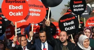 """Turkish demonstrators hold a banner and placards that read """" we are with resistance against aggressors"""" as they protest Russian support to Assad regime in Syria, outside the Russian embassy in Ankara, Turkey, Tuesday, Nov. 24, 2015. Turkey shot down a Russian warplane Tuesday, claiming it had violated Turkish airspace and ignored repeated warnings. Russia denied that the plane crossed the Syrian border into Turkish skies. Russia said the Su-24 was downed by artillery fire, but Turkey claimed that its F-16s fired on the Russian plane after it ignored several warnings.(AP Photo)"""