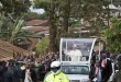Pope Francis waves to local residents as he drives to St. Joseph The Worker Catholic Church in the Kangemi slum of Nairobi, Kenya Friday, Nov. 27, 2015. Pope Francis is in Kenya on his first-ever trip to Africa, a six-day pilgrimage that will also take him to Uganda and the Central African Republic. (AP Photo/Ben Curtis)