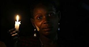 A woman holds a candle as she waits for the arrival of Pope Francis for a meeting with catechists and teachers during his visit to Munyonyo, Uganda, Friday, Nov. 27, 2015. Pope Francis is in Africa for a six-day visit that is taking him to Kenya, Uganda and the Central African Republic. (AP Photo/Andrew Medichini)