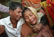 Relatives of people killed when unidentified gunmen attacked a mosque during evening prayers on Thursday grieve before their funeral in Bangladesh's Bogra district, Friday, Nov. 27, 2015. Thursday's attack follows a wave of deadly assaults in 2015 on foreigners, secular writers and the Shiite community in the Sunni majority nation. (AP Photo)