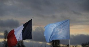 The flags of the U.N. and France fly as world leaders arrive for the COP21, United Nations Climate Change Conference, in Le Bourget, outside Paris, Monday, Nov. 30, 2015. (AP Photo/Christophe Ena, Pool)