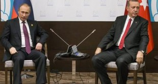 FILE - In this file photo taken on Monday, Nov.  16, 2015, Russian President Vladimir Putin, left, and Turkish President Recep Tayyip Erdogan pose for the media before their talks during the G-20 Summit in Antalya, Turkey.  Putin ordered the deployment of long-range air defense missiles to a Russian military base in Syria and Russia's military said it would destroy any target that may threaten its warplanes following the downing of a Russian military jet by Turkey. (AP Photo/Alexander Zemlianichenko, file)