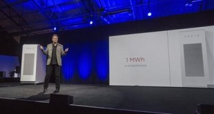 FILE - In this April 30, 2015 file photo, Tesla Motors Inc. CEO Elon Musk unveils the company's newest product, Powerpack in Hawthorne, Calif. Musk is trying to steer his electric car company's battery technology into homes and businesses as part of an elaborate plan to reshape the power grid with millions of small power plants made of solar panels on roofs and batteries in garages. One of the key technologies that could help wean the globe off fossil fuel is probably at your fingertips or in your pocket right now: the battery.  If batteries can get better, cheaper and store more power safely, then electric cars and solar- or wind- powered homes become more viable _ even on cloudy days or when the wind isn't blowing. These types of technological solutions will be one of the more hopeful aspects of United Nations climate talks that begin next week in Paris. (AP Photo/Ringo H.W. Chiu, File)