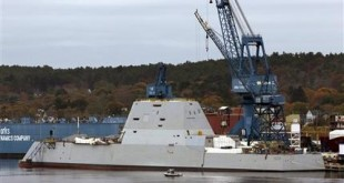FILE - In this Oct. 31, 2013 file photo the Navy's stealthy Zumwalt destroyer is built at Bath Iron Works, in Bath, Maine. The Navy's largest destroyer cuts an imposing figure: massive in size, with an angular shape, hidden weapons, and an unusual hull that fell out of favor a century ago in part because it can be unstable. How this unusual hull shape works in rough seas will be answered when the ship heads to sea in December.  (AP Photo/Robert F. Bukaty, file)