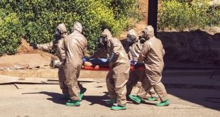 In this photo taken on Tuesday, April 4, 2017 and made available Wednesday, April 5, Turkish experts carry a victim of alleged chemical weapons attacks in Syrian city of Idlib, at a local hospital in Reyhanli, Hatay, Turkey.  A suspected chemical attack in a town in Syria's rebel-held northern Idlib province killed dozens of people on Tuesday, opposition activists said, describing the attack as among the worst in the country's six-year civil war.(AP Photo)