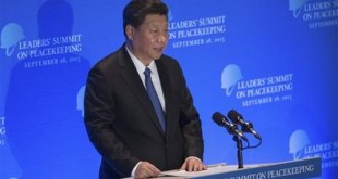 FILE - In this Monday, Sept. 28, 2015 file photo, China's President Xi Jinping speaks at a leaders' summit on peacekeeping at United Nations headquarters. The murders of Chinese citizens by Islamic militants in Syria and Mali place President Xi in a quandary: How can Beijing respond effectively without betraying its strict stance against intervention? The dilemma underscores the tension between China's desire to be seen as a leading global power and its desire to remain independent whiling shunning the U.S.-led Western political agenda. (AP Photo/Kevin Hagen, File)