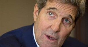 U.S. Secretary of State John Kerry speaks with members of the traveling press during his stop in Abu Dhabi, United Arab Emirates, on Monday, Nov. 23, 2015. (AP Photo/Jacquelyn Martin, Pool)