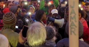 File- This Nov. 20, 2015, file photo shows Minneapolis NAACP leader Nekima Levy-Pounds speaking at a prayer vigil n Minneapolis. Five people have been shot near the site of an ongoing protest over the fatal shooting of a black man by a police officer, a Minneapolis Police Department spokesman said. Spokesman John Elder told The Associated Press in an email just before midnight Monday that five people were shot. All five have injuries that are not life-threatening, he said. (AP Photo/Greg Moore, File)