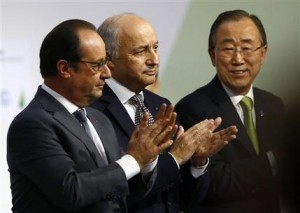 """French President Francois Hollande, left, French foreign minister Laurent Fabius, center, and United Nations Secretary General Ban Ki-moon applaud at the COP21, the United Nations Climate Change Conference, in Le Bourget, north of Paris, Saturday, Dec.12, 2015. Fabius says a """"final"""" draft of a global climate pact would be legally binding. (AP Photo/Francois Mori)"""
