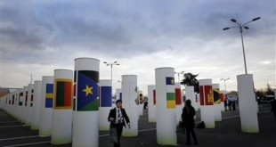 A man walks next to the entrance at the COP21, the United Nations Climate Change Conference Wednesday, Dec. 2, 2015 in Le Bourget, north of Paris. (AP Photo/Christophe Ena)