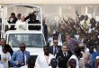 Pope Francis waves to the crowd on the occasion of his visit at the Central Mosque in Bangui's Muslim enclave of PK5, Central African Republic, Monday Nov. 30, 2015. The Pope was welcomed by a crowd of people and prayed inside the Central Mosque. (AP Photo/Jerome Delay)