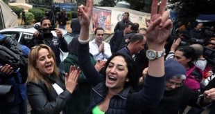 Families of soldiers and policemen who were kidnapped by militants from the Islamic State group and al-Qaida's branch in Syria, the Nusra Front, cheer after following news that their sons were being released, in front of tents set up for a protest in downtown Beirut, Lebanon, Tuesday, Dec. 1, 2015. A group of Lebanese soldiers held captive since August 2014 were being released Tuesday as part of a swap deal. (AP Photo/Bilal Hussein)