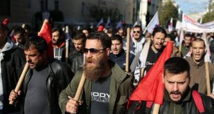 Protesting members of the PAME Communist-affiliated union shout slogans during a 24-hour nationwide general strike in Athens, Thursday, Dec. 3, 2015. Public and private sector workers have walked off the job in Greece's second 24-hour general strike in a month against new austerity measures. (AP Photo/Petros Giannakouris)