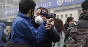 A plainclothes policeman grabs the hand of a foreign journalist as he prevents him from filming the supporters of rights lawyer Pu Zhiqiang's gathering near the Beijing Second Intermediate People's Court in Beijing, Monday, Dec. 14, 2015. Police scuffled with protesters and journalists at the Beijing courthouse Monday as the prominent lawyer stood trial on charges of provoking trouble and stirring ethnic hatred with online commentary critical of the ruling Communist Party. (AP Photo/Andy Wong)