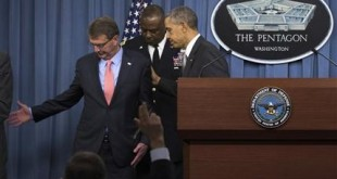 President Barack Obama, Defense Secretary Ash Carter and Commander of U.S. Central Command Gen. Lloyd Austin, leave the podium after the president spoke at the Pentagon, Monday, Dec. 14, 2015, about the fight against the Islamic State group following a National Security Council meeting. The president said the U.S. military and allied forces are hitting the Islamic State group harder than ever. (AP Photo/Evan Vucci)