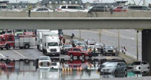 vehicles-and-people-were-flooded-under-the-106-st-over-pass2