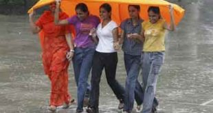 Girls cover themselves from rain in Chandigarh